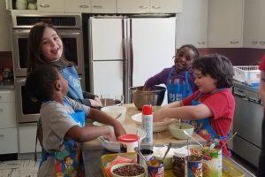 Students make hamentashen for Purim