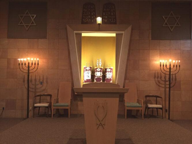 Bimah with 3 Torah scrolls in ark